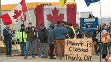 CAW workers picket outside at the Electro-Motive plant in London, Ont., on Friday, Feb. 3, 2012. (Mark Spowart/THE CANADIAN PRESS/Mark Spowart/THE CANADIAN PRESS)