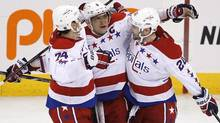 Washington Capitals' Alex Ovechkin (8), John Carlson (74) and Troy Brouwer (20) celebrate Ovechkin's goal against the Winnipeg Jets during third period NHL action in Winnipeg on Thursday, March 21, 2013. (JOHN WOODS/THE CANADIAN PRESS)