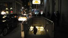 Commuters emerge from the King St. subway station at Yonge St..File photos of downtown Toronto's financial district and area taken at night on Oct 27 2011. (Fred Lum/The Globe and Mail)