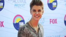 Singer Justin Bieber arrives for the TeenChoice 2012 awards in Los Angeles July 22, 2012. (Phil McCarten/Reuters)
