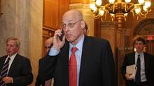 Talking on his cell phone, Henry Paulson enters the U.S. Capitol for a late night meeting with members of Congress on Sept. 25, 2008. (Lauren Victoria Burke)