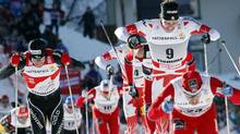 Norway's Eldar Roenning (24) leads Canada's Alex Harvey (9) (AP Photo/Armando Trovati)