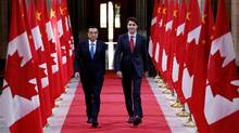The bilateral pact was concluded four days after Justin Trudeau held a telephone discussion with Chinese Premier Li Keqiang, left, where the two leaders focused on a coming third round of exploratory free-trade talks. (Chris Wattie/Reuters)