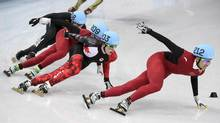 Canada's Charle Cournoyer rounds a corner to place second behind Wu Dajing of China in the men's 500-metre semi-finals at the Sochi Winter Olympics Friday, February 21, 2014 in Sochi. (Paul Chiasson/THE CANADIAN PRESS)
