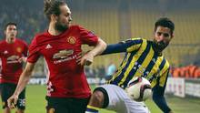 Manchester United's Daley Blind, left, and Fenerbahce's Alper Potuk fight for the ball during a Europa League soccer match in Istanbul on Nov. 3, 2016. (The Associated Press)