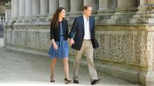 The newly minted Duke and Duchess of Cambridge leave Buckingham Palace Saturday morning, destination unknown. The photo was released by the palace. (Handout)