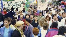 Ann-Marie MacDonald (smiling in the centre of the picture, wearing a red top) at a Pride Day parade in Toronto in the late 1980s. (Courtesy of Cheryl Daniels)