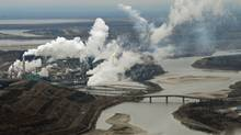 Aerial view of the Suncor oil sands extraction facility on the banks of the Athabasca River and near the town of Fort McMurray, Alta. (MARK RALSTON/AFP/Getty Images)