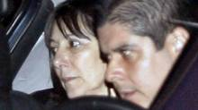 Argentina's then-Economy Minister Felisa Miceli, left, leaves the Casa Rosada government palace accompanied by a driver in Buenos Aires July 16, 2007. Ms. Miceli resigned hours after a prosecutor requested she testify about some $60,000 she had stashed in her office bathroom. (Santiago Pandolfi/Reuters)