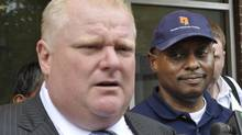 Mayor Rob Ford, left, and Gene Jones, President and Chief Executive Officer of Toronto Community Housing Corporation (TCHC), right talk to the media following a tour of a city highrise at 4400 Jane streeet in Toronto, July 5, 2012. (J.P. MOCZULSKI For The Globe and Mail)