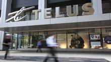 People walking by Telus store in Toronto. (Gloria Nieto/The Globe and Mail)