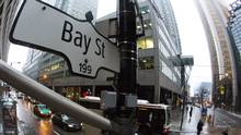 A Bay Street sign, the main street in the financial district is seen in Toronto, January 28, 2013. (Mark Blinch / Reuters)