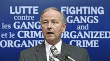 Justice Minister Rob Nicholson announces new regulations to strengthen the ability of law enforcement agencies to fight organized crime during a Montreal news conference on Aug. 4, 2010. (Paul Chiasson/THE CANADIAN PRESS)