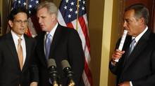 """U.S. House Speaker John Boehner, right, gathers with fellow Republicans Majority Leader Eric Cantor, left, and Rep. Kevin McCarthy, middle, for a news conference at the U.S. Capitol in Washington, February 25, 2013. Pressure is mounting on Congress and the White House to find a way to avoid a package of $85-billion in across-the-board-spending cuts, known as the """"sequester,"""" due to take effect on March 1. (JONATHAN ERNST/REUTERS)"""