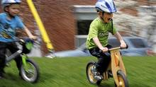 Two and a half-year-old Ben Metzner (L) and his four and a half-year-old friend Philip Scheibehenne ride their pedaless bikes imported and distributed in Canada by Philip's mother Sabine Scheibehenne under the brand Like a Bike, at Wanless Park in Toronto, April 23, 2011. (Fernando Morales/The Globe and Mail/Fernando Morales/The Globe and Mail)