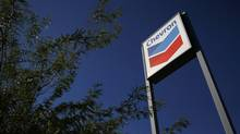 A Chevron sign is displayed at a gas station in Buckeye, Ariz., in this Oct. 27, 2011 file photo. (JOSHUA LOTT/REUTERS)