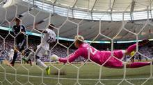 Vancouver Whitecaps goalkeeper David Ousted, right, of Denmark, dives along the goal line as teammate Nigel Reo-Coker, centre, of England, stops San Jose Earthquakes' Chris Wondolowski's shot during the second half of an MLS soccer game in Vancouver, B.C., on Saturday August 10, 2013. (DARRYL DYCK/THE CANADIAN PRESS)
