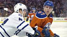 Toronto Maple Leafs' Morgan Rielly battles for the puck with Edmonton Oilers' Connor McDavid during a game in Edmonton on Thursday, Feb. 11, 2016. The Oilers defeated the Maple Leafs 5-2. (Jason Franson/The Canadian Press)
