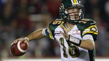 Edmonton Eskimos quarterback Matt Nichols scrambles to pass the ball during the first half of their CFL football game against the Calgary Stampeders in Calgary, Alberta, September 28, 2012. (TODD KOROL/REUTERS)