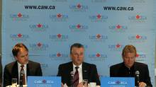 Canada Auto Workers economist Jim Standford, left, CAW president Ken Lewenza, centre, and CAW Secretary-Treasurer Peter Kennedy during a press conference in Toronto on April 16, 2012. (Fernando Morales/The Globe and Mail)