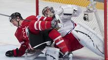 Canada's Justin Schultz collides with Czech Republic goalie Ondrej Pavelec during second period preliminary round action Sunday, May 12, 2013 at the world hockey championship in Stockholm Sweden. Schultz got a two-minute penalty on the play. (Jacques Boissinot/THE CANADIAN PRESS)