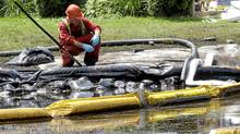 Water in Talmadge Creek in Marshall Township, Mich., near the Kalamazoo River, is monitored after 20,000 barrels oil from a ruptured pipeline, owned by Enbridge Inc., spilled into the river's watershed. (Paul Sancya/Associated Press/Paul Sancya/Associated Press)