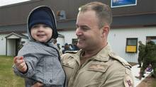 Maj. Yves LeBlanc, a CP-140 Aurora pilot, holds his two-year-old son Jeremy after returning from Operation Mobile, Canada's military contribution to the crisis in Libya, in Greenwood, N.S. on Saturday, Nov. 5, 2011. (Andrew Vaughan/THE CANADIAN PRESSAndrew Vaughan/Andrew Vaughan/THE CANADIAN PRESS)