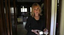 Beth Teolis, 62, stands in the doorway of her home in Toronto, June 14, 2012, with the last of her medication, the drug Rythmodan, used to help regulate heart rhythm, that was pulled off the shelves without warning from the drug company. The company promises to restock it, but who knows when. Patients are running low on their supply -- and are at risk of having to undergo invasive heart surgery. (Deborah Baic/The Globe and Mail)