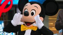 Mickey Mouse attends the grand opening of the Times Square Disney Store on November 9, 2010 in New York City.