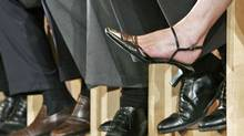 The feet and legs of running for the federal Liberal leadership are shown during a question and answer session at the party's women's caucus meeting in Vancouver on Aug. 22, 2006. (ANDY CLARK/Reuters)