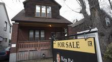 A for sale sign is seen at a house in East York on march 6, 2017. (Fred Lum/The Globe and Mail)
