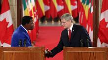Prime Minister Stephen Harper, right, and the President of the Republic of Benin Thomas Boni Yayi shake hands after holding a joint news conference on Parliament Hill in Ottawa Jan. 8, 2013. (FRED CHARTRAND/THE CANADIAN PRESS)