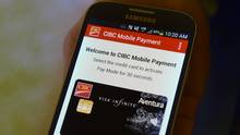 The CIBC's mobile payment app (pictured on a Samsung device, Apple iPhones can't use this app since the technology required isn't present in their devices) is seen in this file photo. (Fred Lum/Fred Lum/The Globe and Mail)