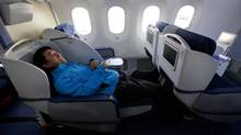 Getting an upgrade to first class could mean the ability to lie flat, and stretch your legs. (John Froschauer/AP)