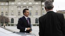 Swiss National Bank Chairman Philipp Hildebrand arrives in front of the Swiss National Bank building (back) for a news conference in Bern January 9, 2012. Hildebrand resigned with immediate effect. (MICHAEL BUHOLZER/MICHAEL BUHOLZER/REUTERS)