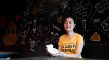 Lien Nguyen, owner of Poop Café – opening on Sept. 7 in Toronto's Koreatown – holds a toilet-shaped bowl imported from Vietnam. The restaurant specializes in poop-shaped fare. (Julien Gignac/The Globe and Mail)
