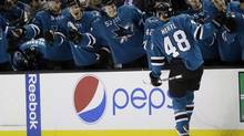 San Jose Sharks' Tomas Hertl (48), of the Czech Republic, celebrates his goal with teammates during the first period of an NHL hockey game against the Ottawa Senators on Saturday, Oct. 12, 2013, in San Jose, Calif. (Marcio Jose Sanchez/AP)