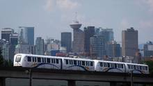 A Skytrain travels past the downtown skyline in Vancouver, B.C. (DARRYL DYCK For The Globe and Mail)
