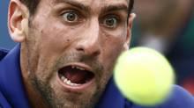 Novak Djokovic of Serbia hits a return to Stanislas Wawrinka of Switzerland during their men's singles match at the U.S. Open in New York September 5, 2012. (EDUARDO MUNOZ/REUTERS)