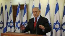 Israeli Prime Minister Benjamin Netanyahu delivers a statement at his office in Jerusalem on Jan. 23, 2013. (Darren Whiteside/Associated Press)
