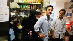 Frank Yeung, in blue shirt, and partner Nick Troen, in white shirt, stand in their kitchen of Poncho No8 a burrito and taco fast food restaurant in London on June 14, 2010.