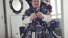 Stefania Capovilla cuts Finance Minister Jim Flaherty's hair on Feb. 10, 2014. (JIM FLAHERTY)
