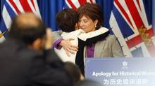 Premier Christy Clark, hugs Teresa Wat, Minister Responsible for Multiculturalism, at an event to recognize the formal apology to British Columbia's Chinese-Canadians for historical wrongs by past provincial governments at B.C. Legislature in Victoria, B.C. Thursday May 15, 2014.THE CANADIAN PRESS/Chad Hipolito (CHAD HIPOLITO/THE CANADIAN PRESS)