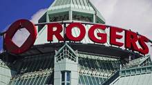The Rogers sign is seen atop the Rogers Communications Inc. headquarters in Toronto. (MARK BLINCH/REUTERS)