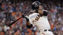 This July 14, 2012 file photo shows San Francisco Giants' Melky Cabrera swinging for an RBI single off Houston Astros' Lucas Harrell in the fifth inning of a baseball game in San Francisco. (Ben Margot/The Associated Press)