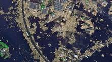 An aerial view of tsunami-ravaged Sendai on March 14. Ottawa is warning Canadians to avoid non-essential travel to Japan, including to Tokyo. (The Associated Press/DLR-ZKI/The Associated Press/DLR-ZKI)