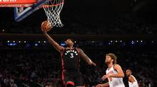 Toronto Raptors forward James Johnson (3) reaches for the net during the first quarter against the New York Knicks at Madison Square Garden. (Anthony Gruppuso/USA Today Sports)