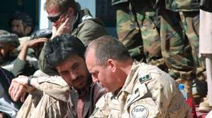 Asadullah Khalid, then governor of Kandahar, chats with Lt-Col. Dana Woodworth, the Canadian commander of the Provincial Reconstruction Team Base, at Sha Wali Kot, Afghanistan, on Feb. 11, 2008.