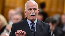 Minister of Public Safety Vic Toews delivers an announcement during Question Period in the House of Commons on March 4, 2013. The government says it will continue to pay for the First Nations Policing Program for the next five years. (Sean Kilpatrick/The Canadian Press)