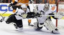 Pittsburgh Penguins' Kris Letang (58) and Marc-Andre Fleury (29) cannot stop a goal by Philadelphia Flyers' Jakub Voracek, of the Czech Republic, in the first period of Game 4 in a first-round NHL Stanley Cup playoffs hockey series on Wednesday. (Matt Slocum/Associated Press)
